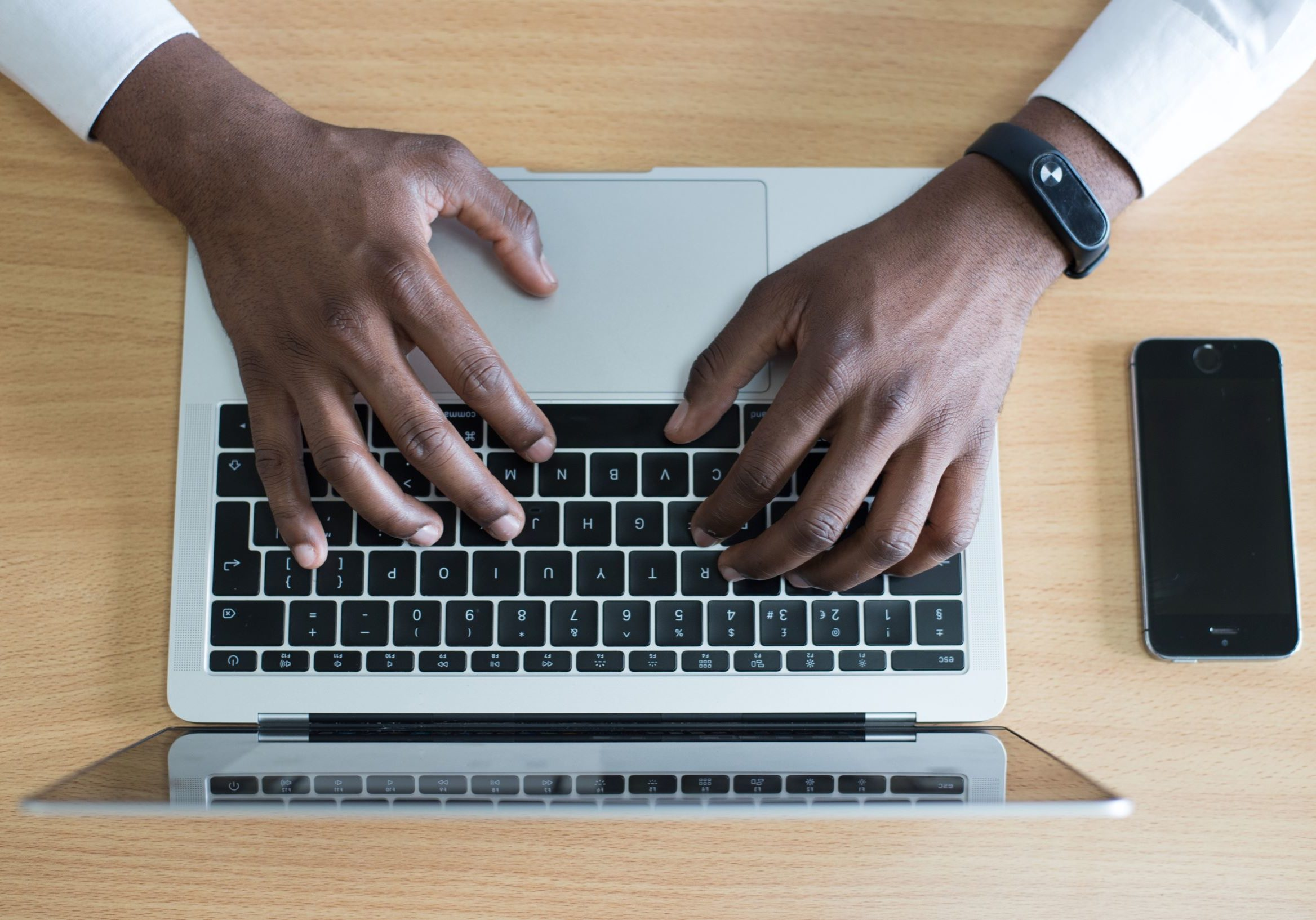 closeup-photo-of-person-s-hands-on-macbook-beside-space-gray-955402 (2)_resized