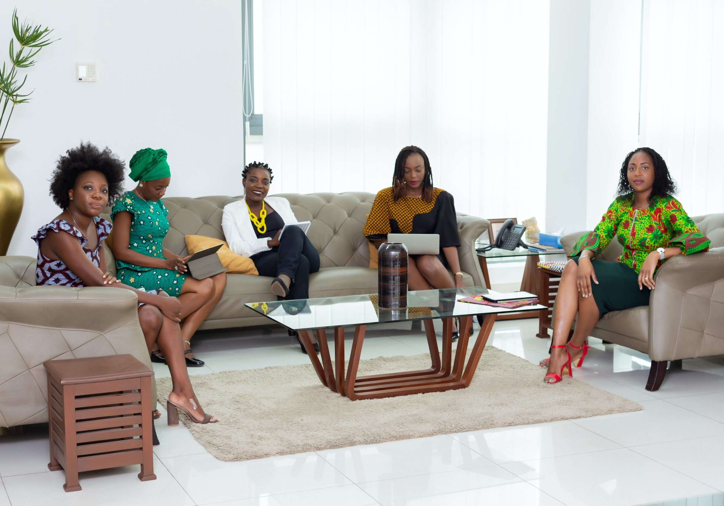 group-of-women-sitting-on-couch-3869651